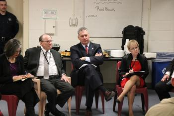 Judge Kathe M. Tuttman (from left) Supreme Judicial Court Chief Justice Ralph D. Gants, Middlesex Sheriff Peter J. Koutoujian and Trial Court Chief Justice Paula M. Carey listen as an incarcerated individual speaks during a court listening session at the Middlesex Jail & House of Correction in Billerica, Mass.