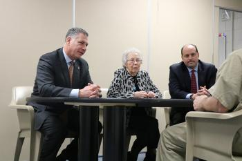 "Middlesex Sheriff Peter J. Koutoujian (from left), Dorothy ""Dot"" Werst and State Senator Jamie Eldridge speak with an incarcerated individual at the Middlesex Jail & House of Correction."